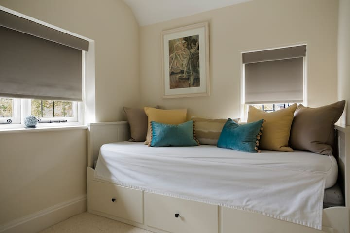 Bedroom 4 is a small bedroom with single daybed that converts to a double bed if required.  This bedroom also has a view to the back garden and a small wardrobe/drawers.
