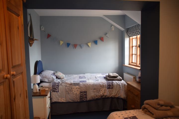 Twin bedroom - one side of the room