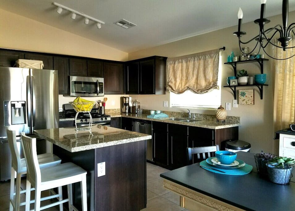 Decorator colors with stainless appliances and granite countertops.