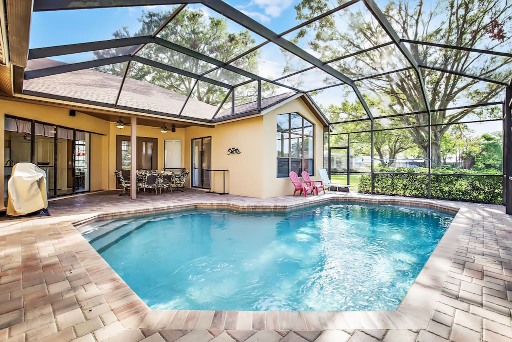 Large tiled pool area and pebble tech pool