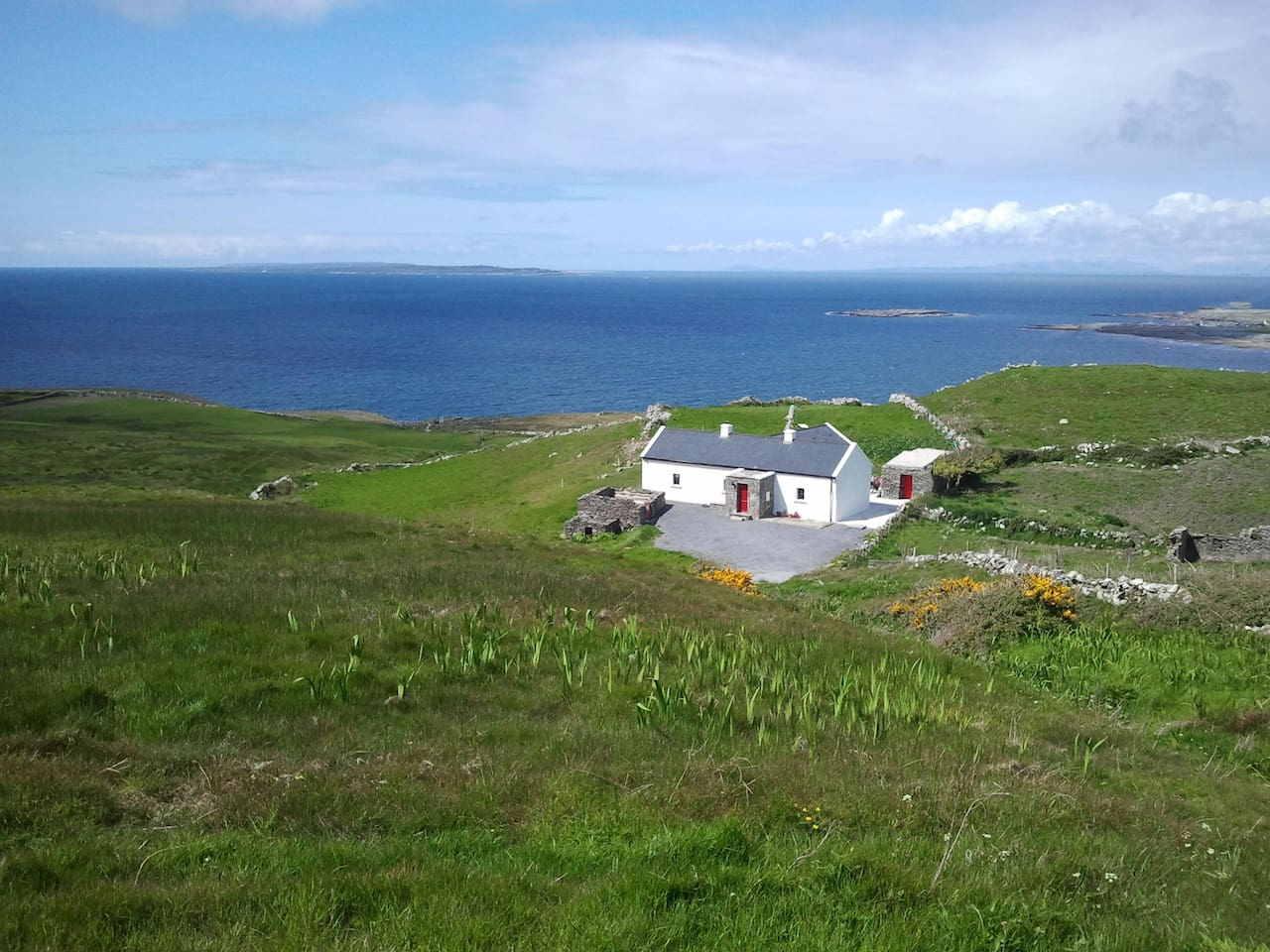 The Russell Cottage, Doolin, Co. Clare with The Aran Islands in the background