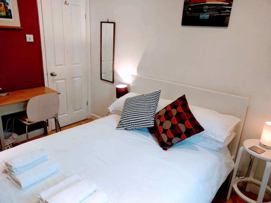 Standard double bed (IKEA) with 100% cotton bed linen. Room is decorated with Latin American art.