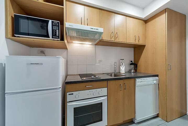 The kitchen is fully furnished and also houses the washing machine and drier.