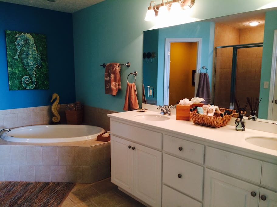 Master bathroom has separate garden tub and walk in shower, with a double vanity.