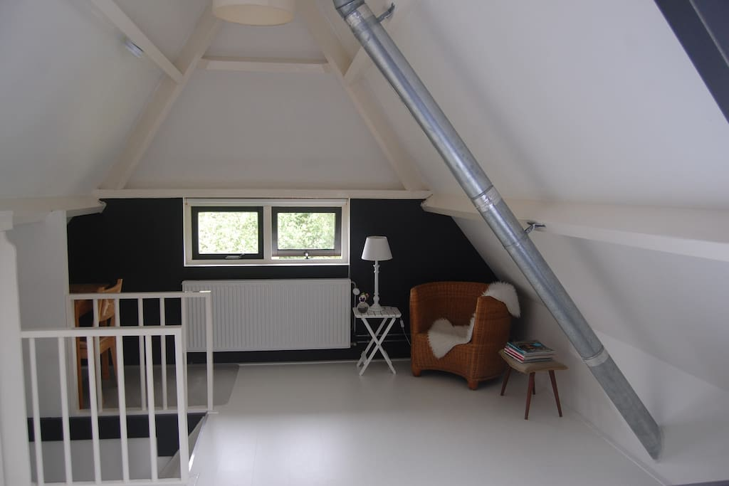 Room with writing desk and seating
