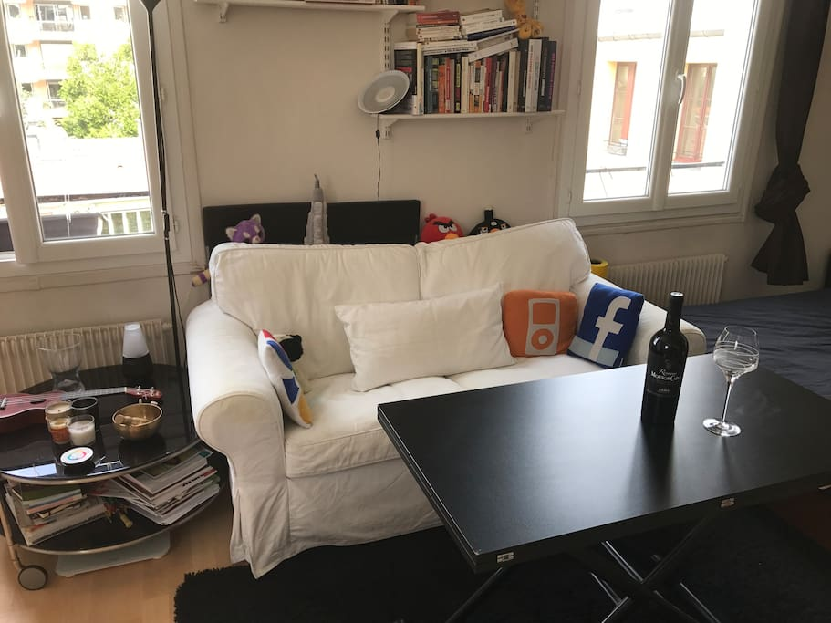 Living Room With Cough And Adjustable Table