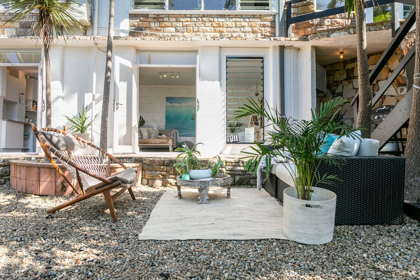 Backyard oasis with large comfy outdoor lounge, chairs, a hammock to relax in, outdoor shower to rinse off after a beach swim & double french doors into the studio. Light airy & so peaceful! BBQ to enjoy & a fire-pit to roast marshmallows & stargaze!