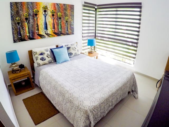 The master bedroom offers natural light and a peaceful atmosphere, with its own private bathroom