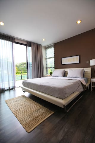 This is the master bedroom which opens onto a terrace at the orange front of the house.