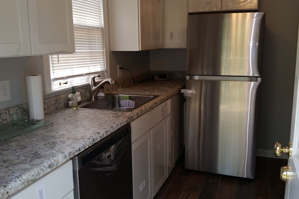 New kitchen with stainless appliances