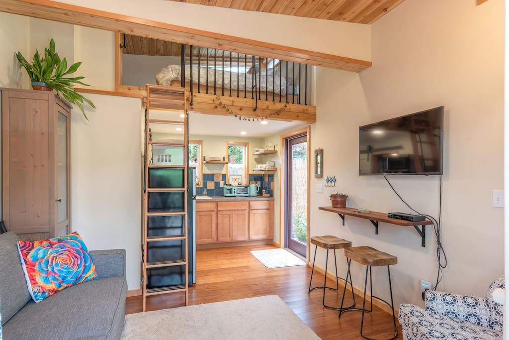 Cozy, comfie queen loft bed up a super secure hand crafted ladder. Cable tv.