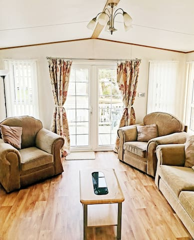 Spacious lounge with french doors leading onto patio area.