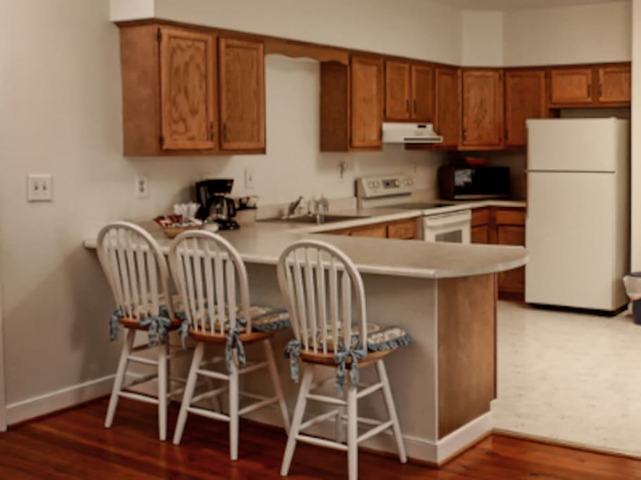 The kitchen area of the Dogwood Suite with refrigerator, microwave and coffee machine.