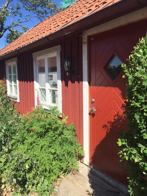 Stay on the countryside, in a red cottage