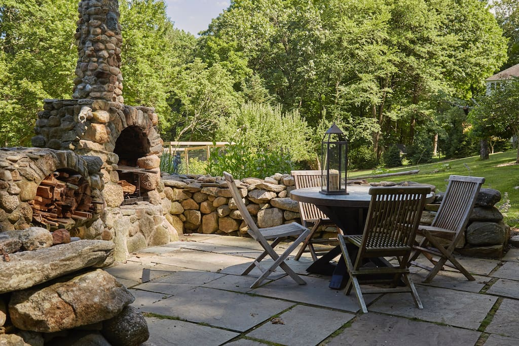 Enjoy the stone patio and fireplace, stocked with all the wood you can burn