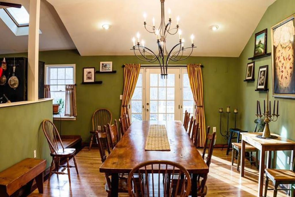 14 foot dinning room table. Hand crafted by owner.  Front door which opens on to a front porch with cozy chairs