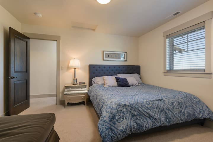 Upstairs guest bedroom with king bed, comfortable oversized chaise lounge and large closet