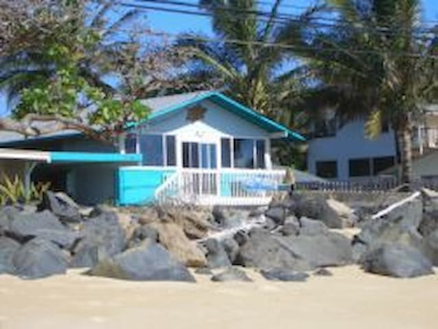 Front door is 50 feet from the water.  There is a 2 lane road between the house and the beach.