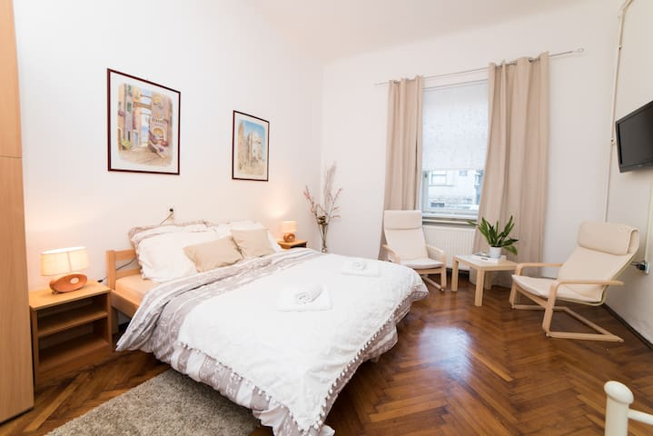 Room 1, first one on the left when you enter apartment. Accommodates max 3 persons. Bed on the picture is set up from 2 single beds (that can be separated). Equiped with AC and TV.