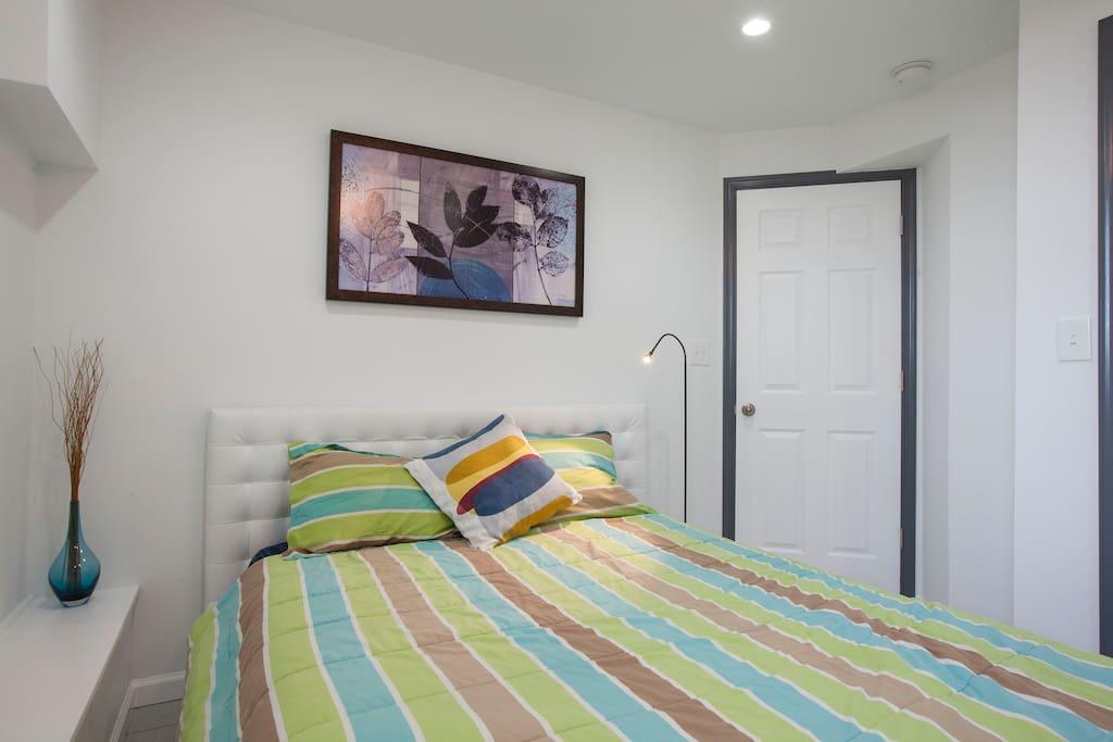 Bedroom 1: Queen Bed with full closet