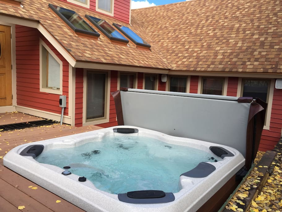 Private recessed Bullfrog Spas hot tub just steps from the door