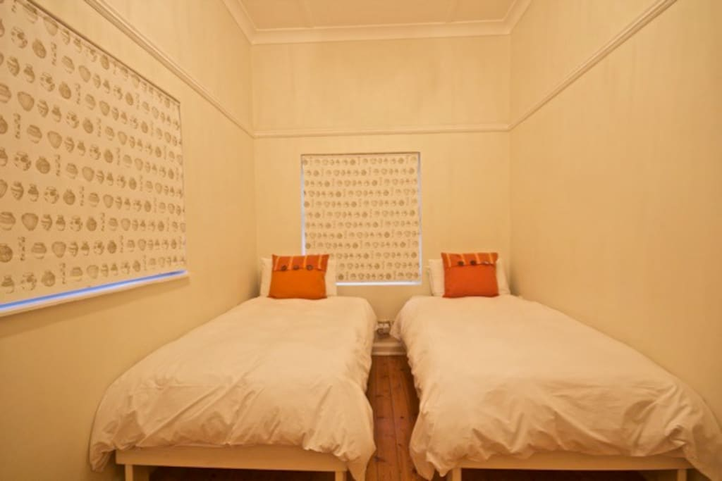 Second bedroom with 2 single beds and wardrobe