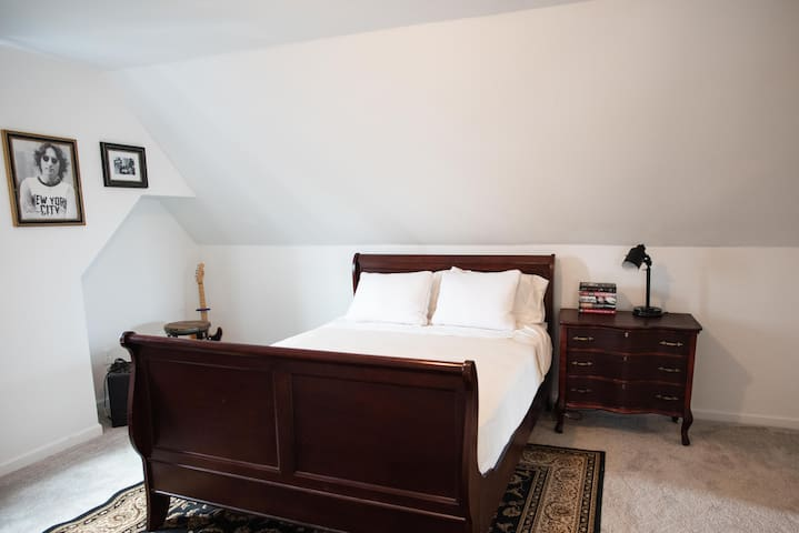 MUSIC BEDROOM suite with Queen-size bed and lounge area located on third level.