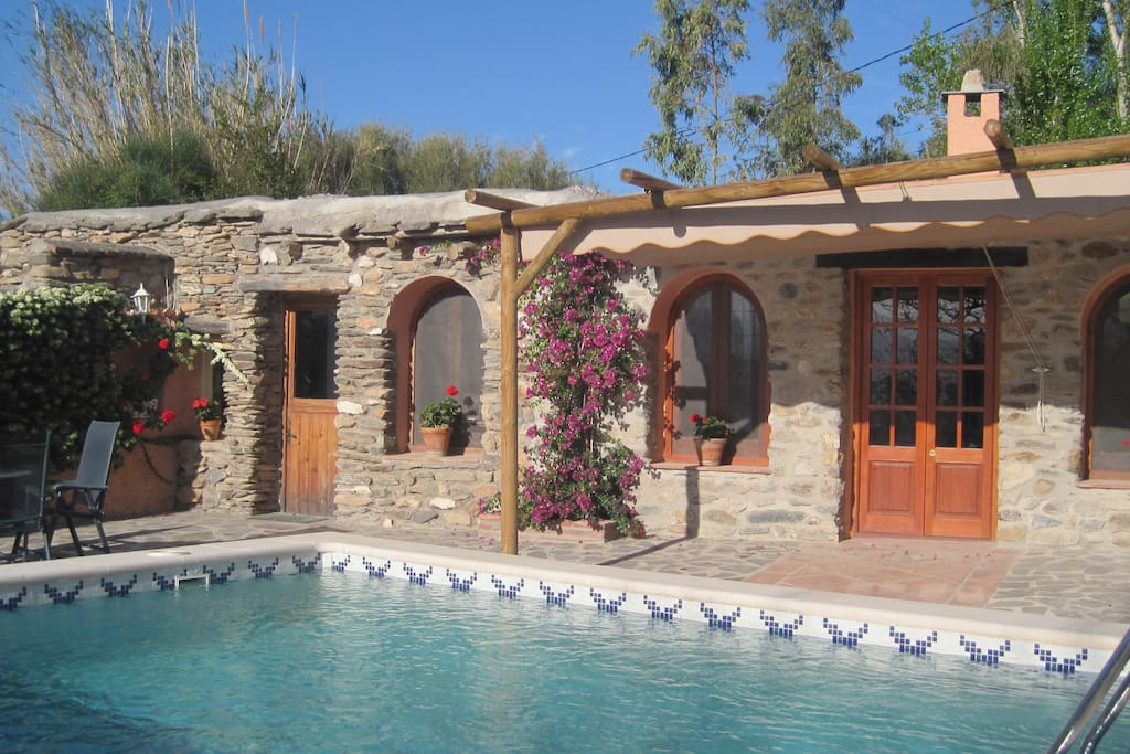 The French doors of the lounge open on to the swimming pool