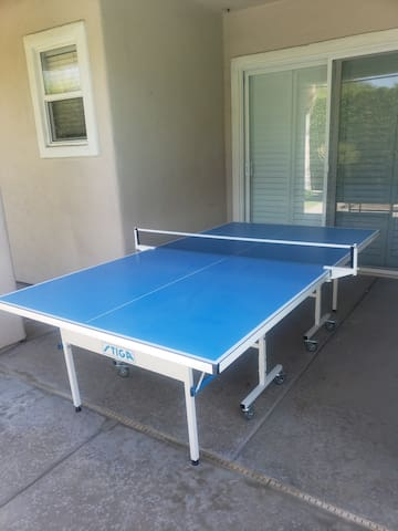 New, regulation outdoor ping pong table with paddles and balls.