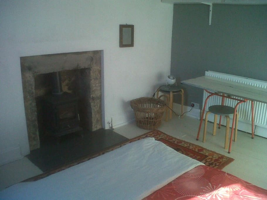 !st floor double guest bedroom with wood stove and central heating