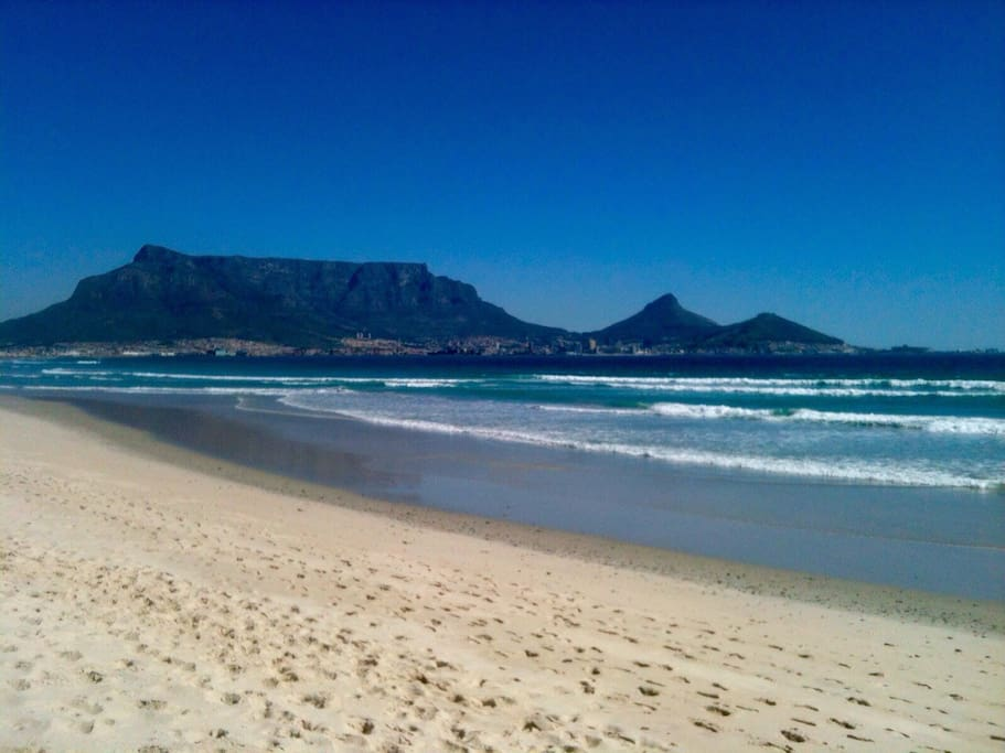 Famous view from our back yard beach: Table Mountain, Lions head,Signal Hill, and on the far right the Cape Town Stadium