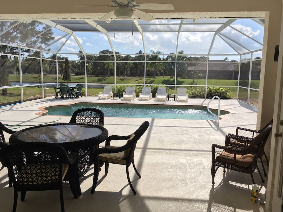 Plenty of outdoor seating in the screened in pool area