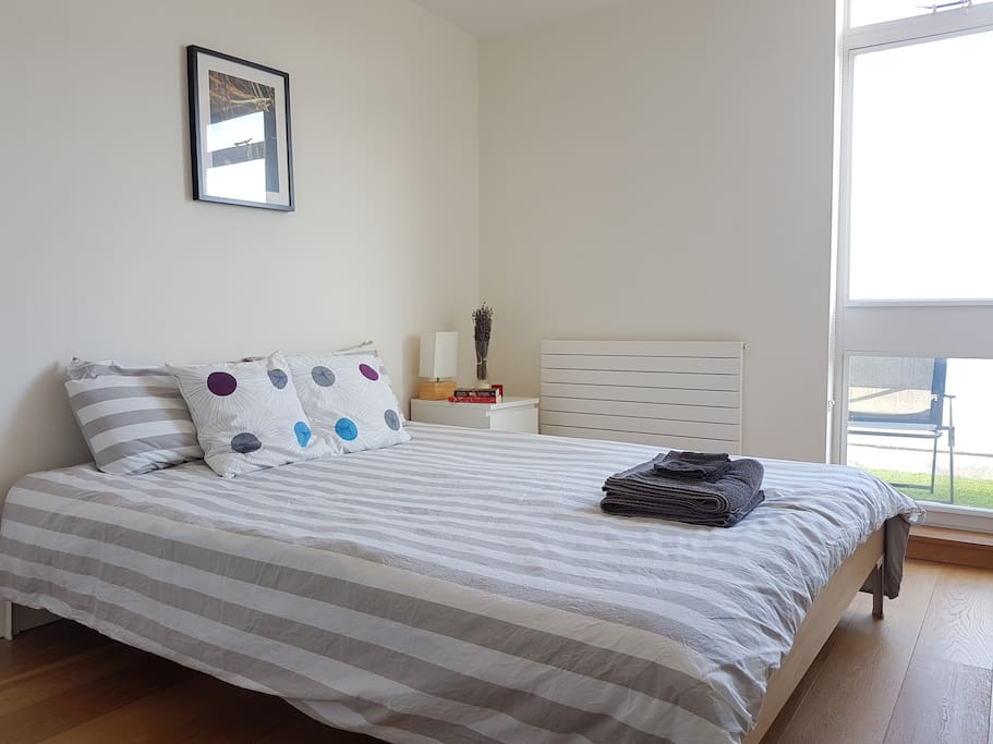 Main bedroom with king-size bed and big build-in wardrobe