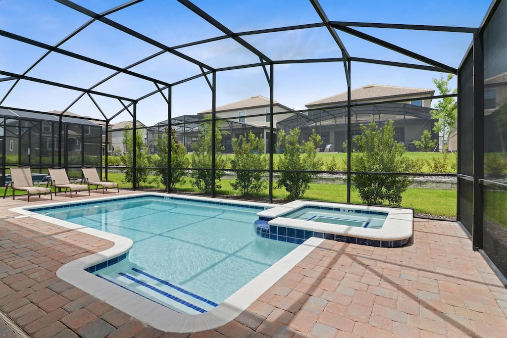 Make magical memories as a family when you stay in this wonderful ChampionsGate home and play in and around this sparkling clear pool. The pool is fitted with a removable pool safety fence.