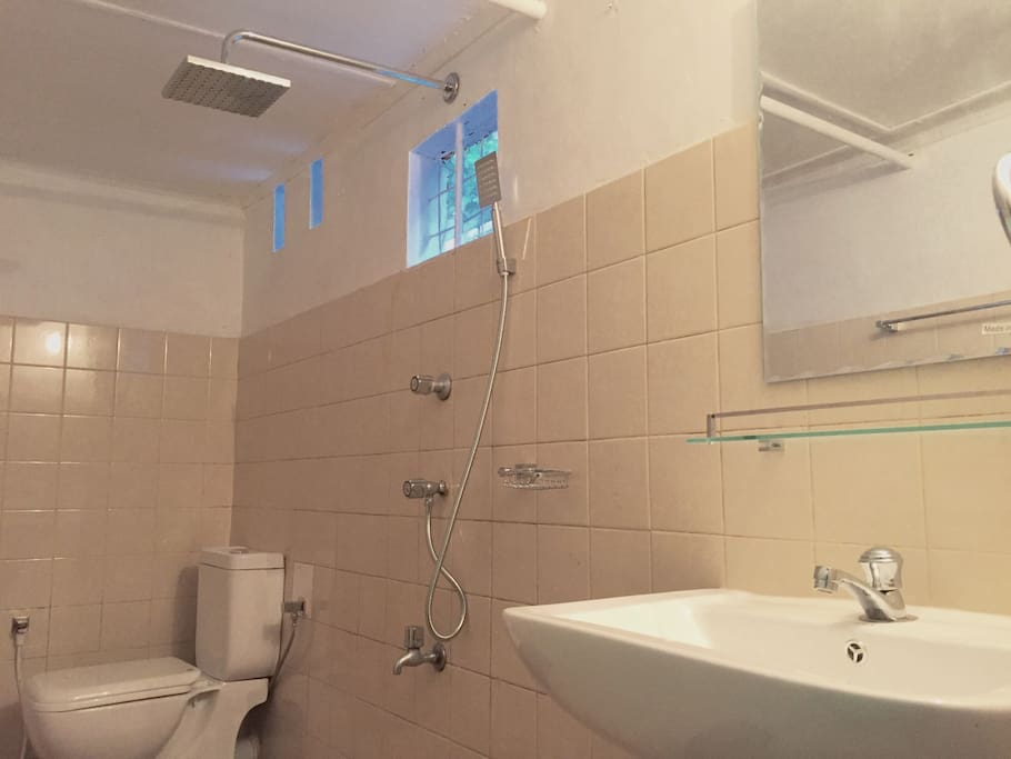 Attached toilet with rain water shower, hand shower.