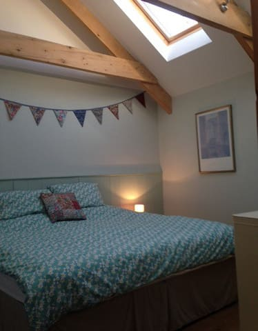 King sized double bed with en suite bathroom