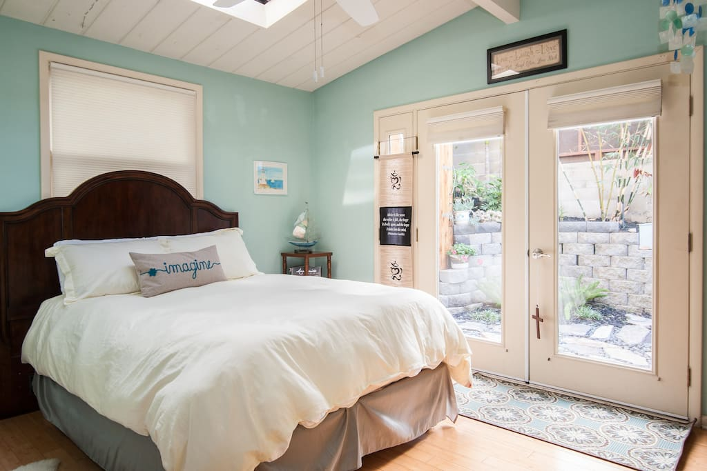Bright and airy room. French doors lead to outdoor spa.