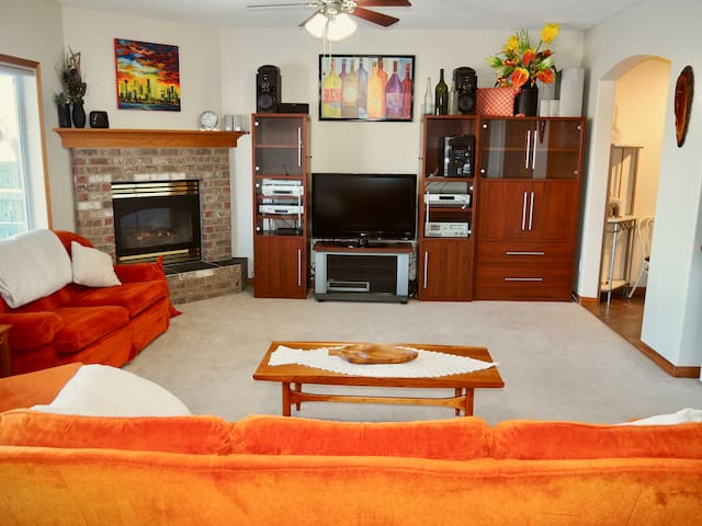 Fire place and entertainment centre, warm in-floor heat, large sunny windows