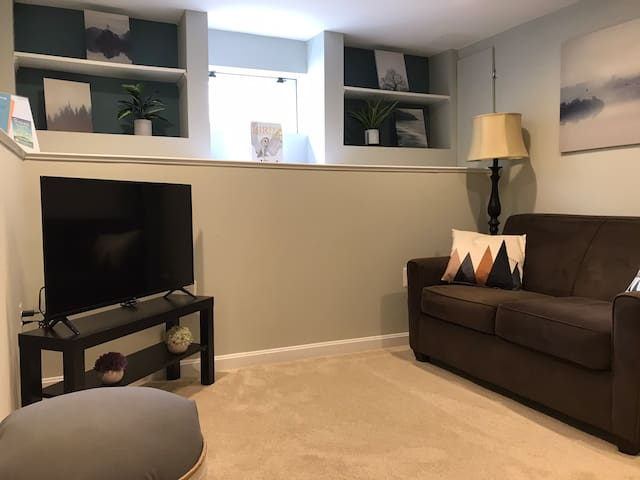 Living room contains loveseat and a futon that pulls out to a full size bed