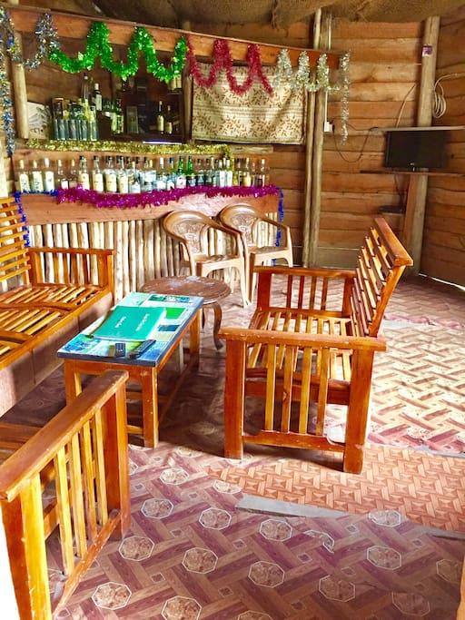 Own private bar, table tennis, hammocks, dart board!