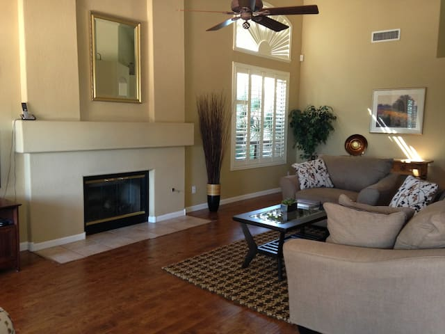 Spacious Living room with access to rear yard and pool.