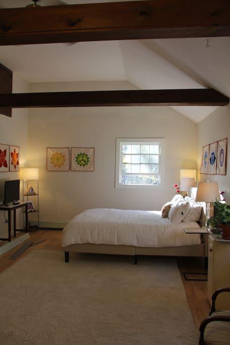 High ceilings with a ceiling fan and window AC. Cozy heat baseboard heat in winter.