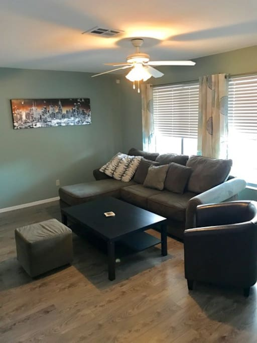 Living/TV room with expandable sofa for 2