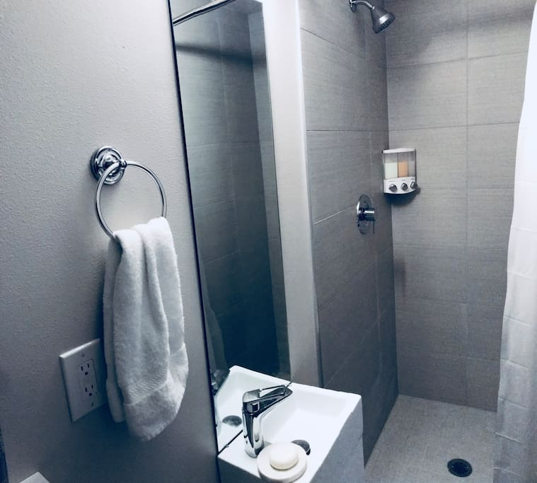 Your private shower, with essentials such as Shampoo, Conditioner and Body Wash, soap and towels.