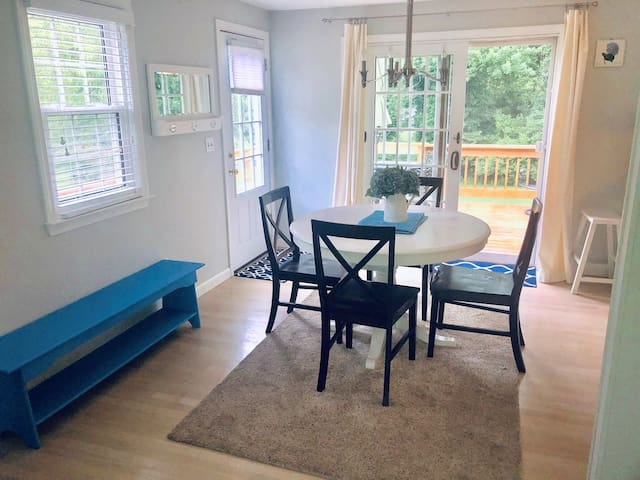 Kitchen eat-in (seat 6 when table pulled out) and slider to deck