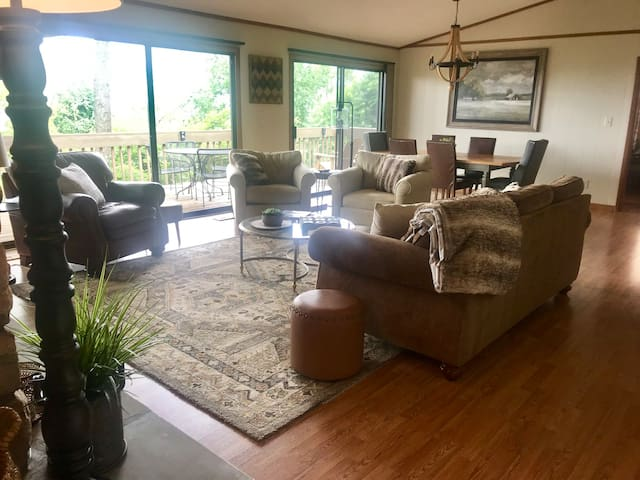 Upstairs living / dining area with full access to deck