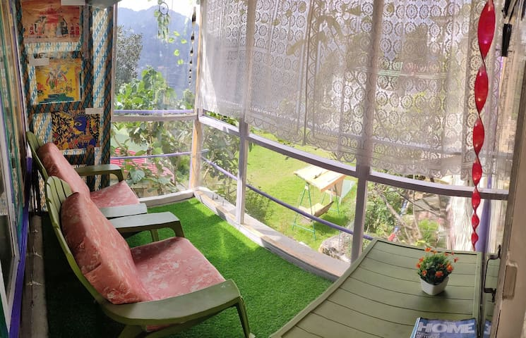 Private Balcony with Garden and Lake view.  Read a book or have home-cooked food here while enjoying the beautiful view of the garden and the Naini lake