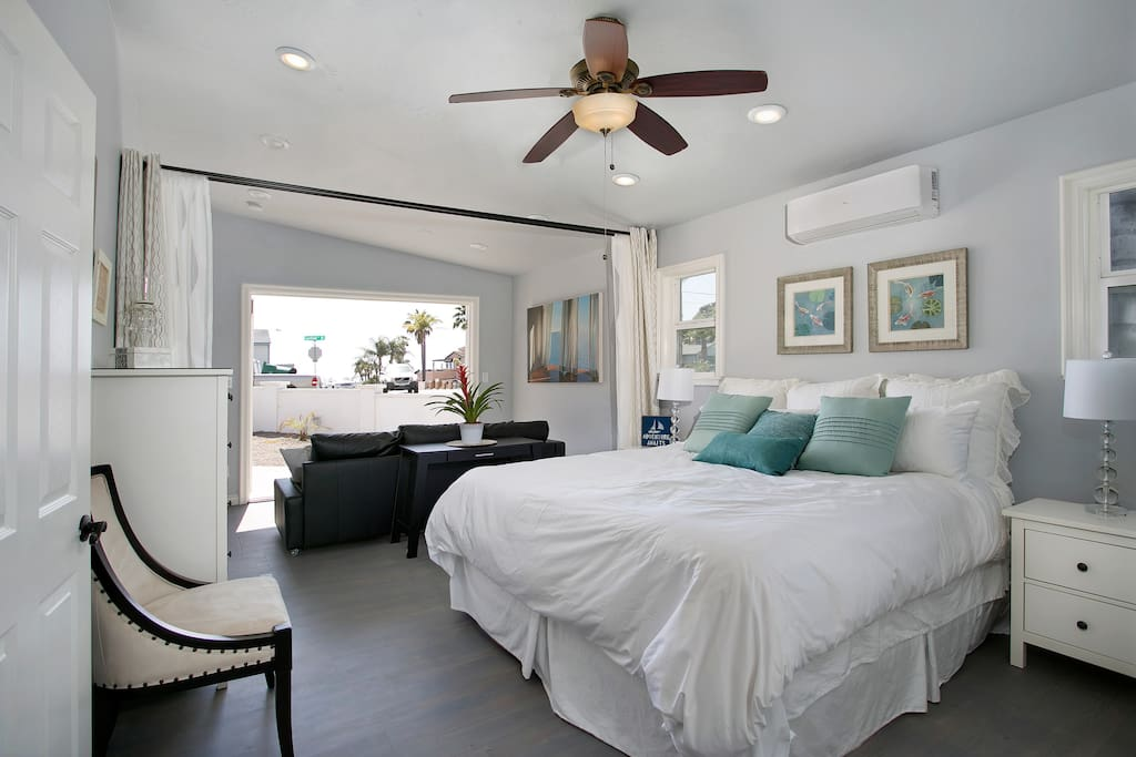 Serene master bedroom features a king-size bed and sitting area.