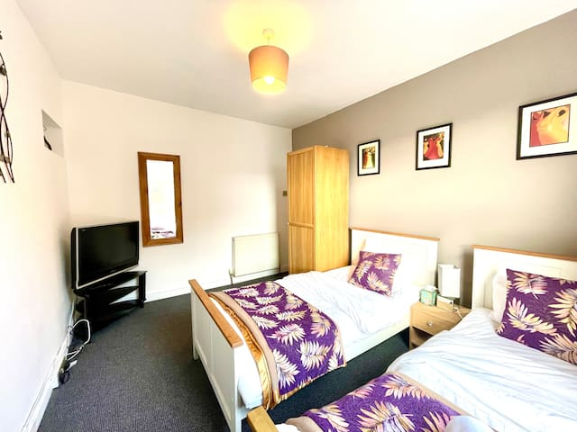 Bedroom 3- A perfect room for sharers who enjoy  their own social space and watch tv from the comfort of their bed.