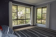 Bedroom 1 - with private garden views on 3 sides.